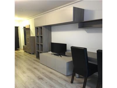 garsoniera pentru investitie se vinde utilata si mobilata zona titan nou Bucuresti